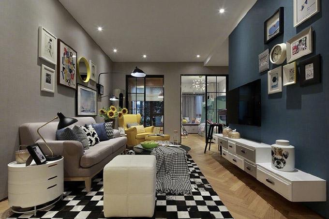 客厅地板与地毯形状互相搭配,色彩也是渐变,电视与沙发背景墙的装饰互相映衬,下面的柜子装饰得也非常个性。