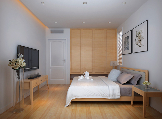 大大的房间以嵌入式的衣柜为背景,装饰简约而不失它的整体性,色彩也是简单明了,视觉上给人一种放松的感觉,非常清新。