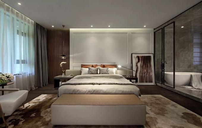 卧室第一眼呈现的是抽象画,色彩与地毯刚好相符,以黑色格子的玻璃来作为隔断,把这种大气表现得淋漓尽致。