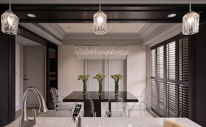 餐厅以一个单独的空间设计在厨房旁边,白色的墙面再配上黑漆,石膏以灰色来点缀,水晶灯看起来十分的文艺高雅,提升了整个空间的档次。