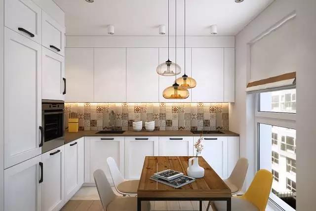 边上的新时代开放式厨房设计十分的洁净,中间腰线的瓷砖装饰可以说是